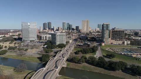 Aerial shot moving towards downtown Fort Worth, Texas over the 7th street bridge.