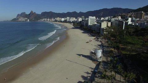 City of Rio de Janeiro, State of Rio de Janeiro, Brazil, South America - 08/29/2018 Arpoador, famous Rio de Janeiro Beach in the Brazilian summer, ocean side of surfboard. Cariocas on Ipanema beach.