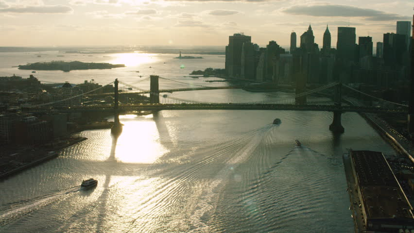 Aerial view of the East river and the bridges and buildings, skyline New York City. New York Aerial. Shot on 4k RED camera on helicopter.