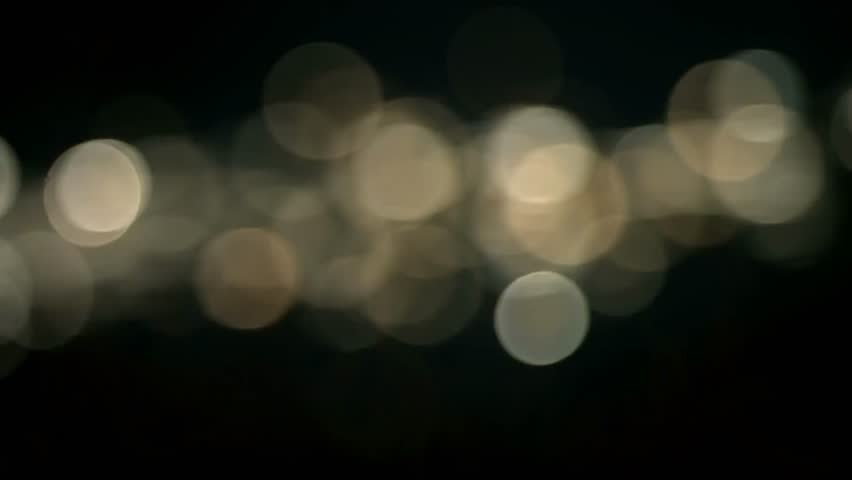 Christmas golden light shine particles bokeh loopable from top on black background, holiday congratulation greeting party happy new year, christmas celebration concept | Shutterstock HD Video #1024151189