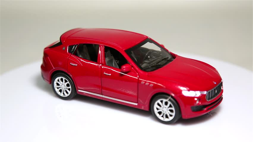Red sports car is rotating isolated on a white background. | Shutterstock HD Video #1024152299