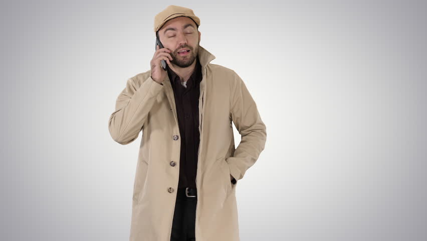 Young fashionable businessman talking on mobile phone on gradient background. | Shutterstock HD Video #1024166879