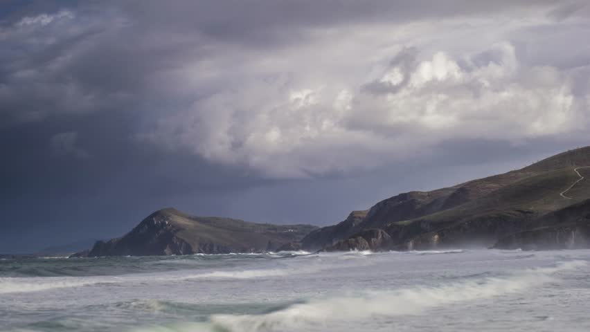 Time lapse of a cliffs with wild waves and many clouds #1024210109