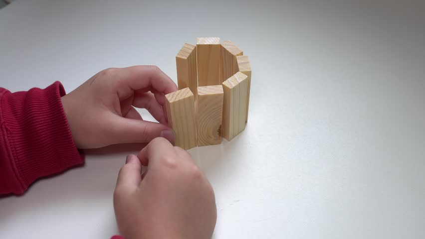 Little child playing with lots of Wooden blocks indoor.  | Shutterstock HD Video #1024231439