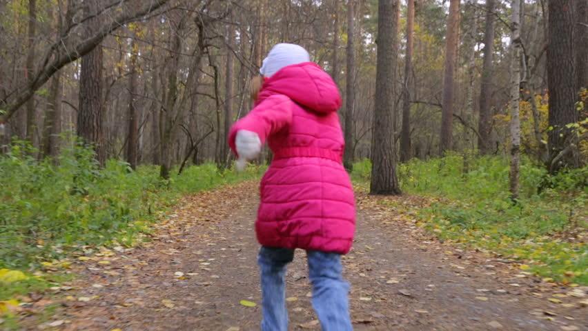 Little girl is running in autumn park | Shutterstock HD Video #1024245749