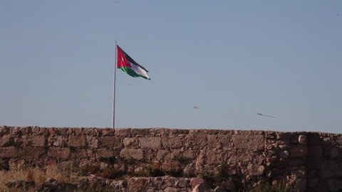 Jordan flag and kites flying over the city/Amman,JORDAN