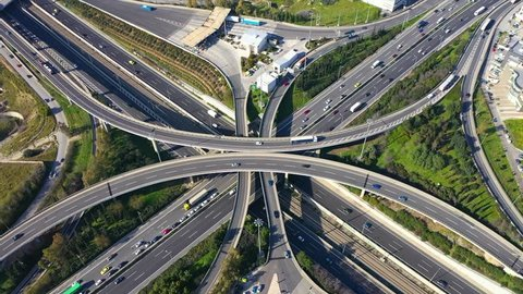Aerial drone video of modern highway multilevel junction with interchange crossing road