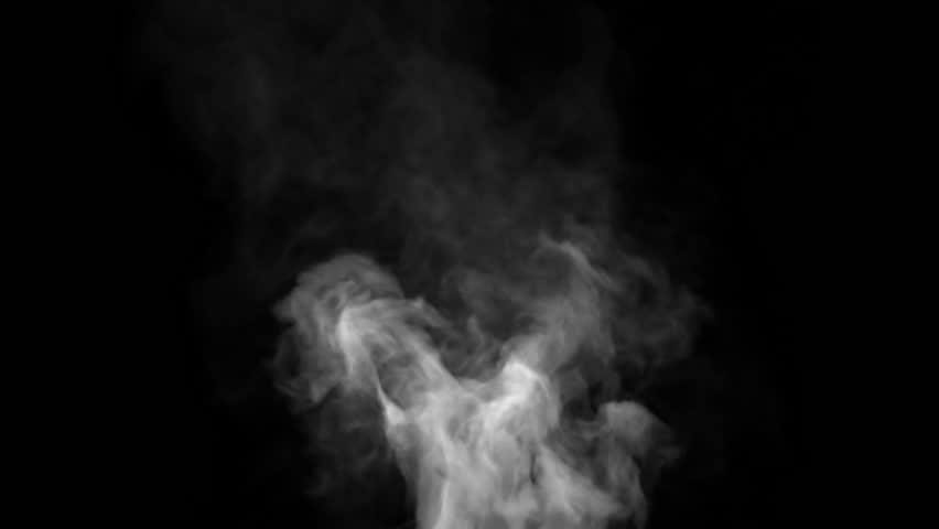 White steam spins and rises from the pan. White smoke rises from a large pot, which is located behind the frame. Isolated seamless loop black background.