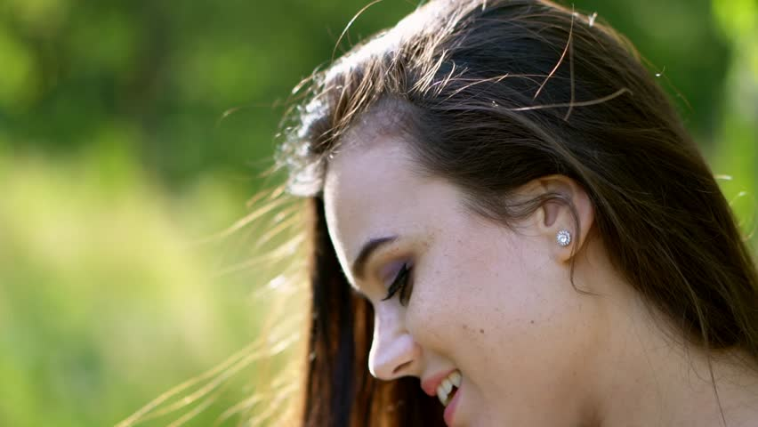 Beautiful Young Girl Smiles And Looks Away. Bright Portrait Of Pretty Woman Looking Sideways And Smiling. Side-View | Shutterstock HD Video #1024345589