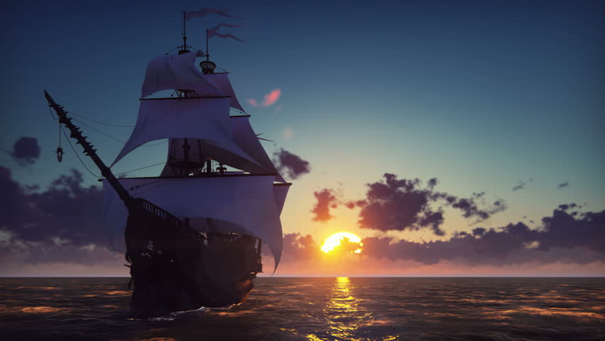 Large medieval ship on the sea on a sunset. The old medieval ship gracefully sails in the open sea.