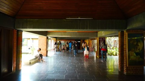 Ahmedabad, Gujarat, India - Circa 2018: Visitors to the halls of the sabarmati ashram in Gujarat India, which has multiple exhibits of how Mahatma Gandhi lived, his belongings and lifestyle. This