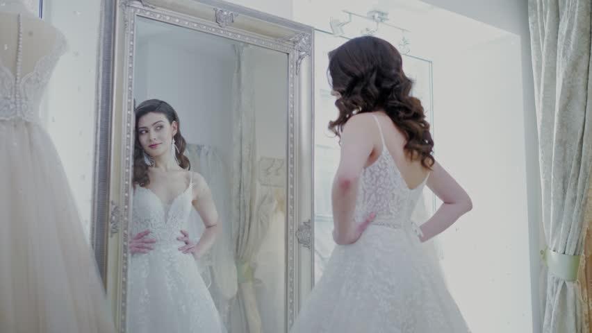 Beautifu Bride Choosing Wedding Dress Stockvideos Filmmaterial