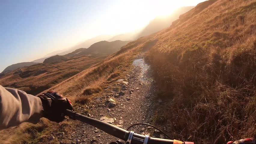 Onboard camera: Mountain biking downhill in stone road in Slate Mountain, Great Britain. View from first person perspective POV. 50 fps | Shutterstock HD Video #1024490909