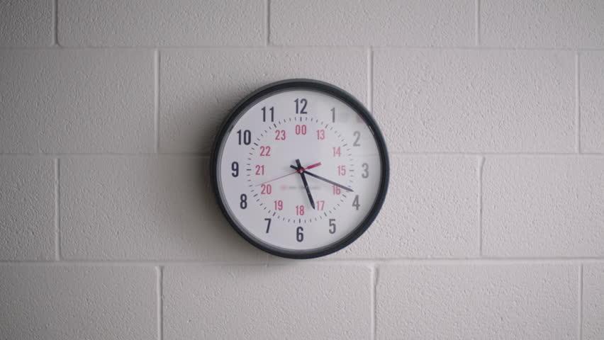 Large clock in high school hallway classroom. Filmed with Arri Alexa Mini | Shutterstock HD Video #1024494899