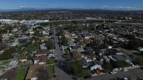Aerial view of residential neighborhood Streets in the suburbs of Anaheim California 4K 02.MOV
