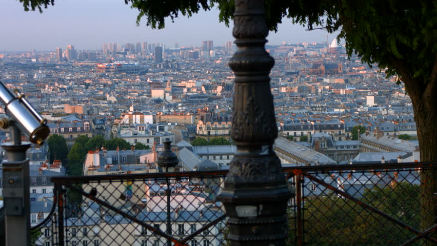 View of Paris from the top of the hill of Montmartre. It is morning and the zinc roofs give a blueish feel to the pictures.
