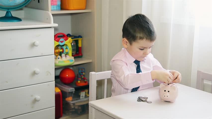 A little boy puts money in a piggy Bank HD 1920x1080 | Shutterstock HD Video #1024550219