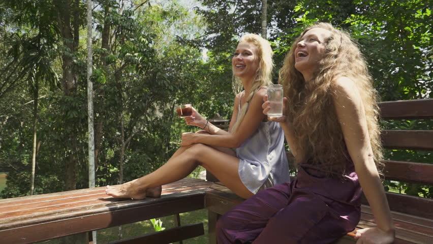 Girls on veranda talking and laughing on steady shot. | Shutterstock HD Video #1024584839