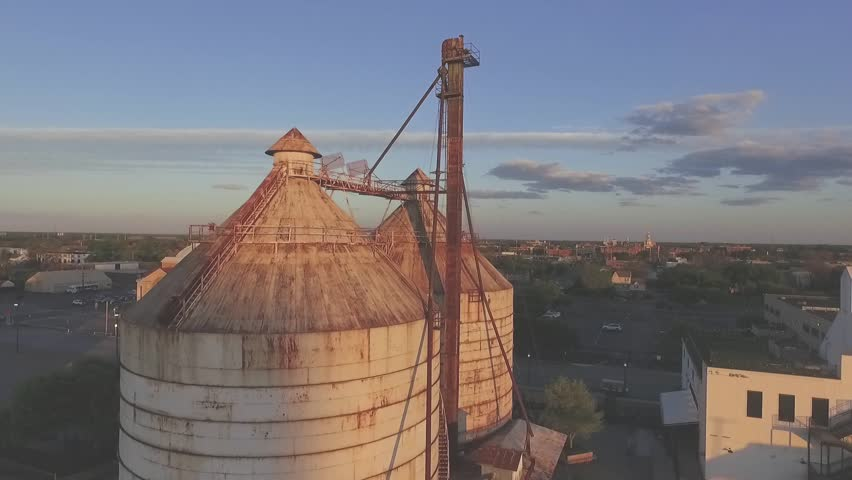 Waco Texas 2018: Drone shot of Magnolia Market at the Silos with sunset in background