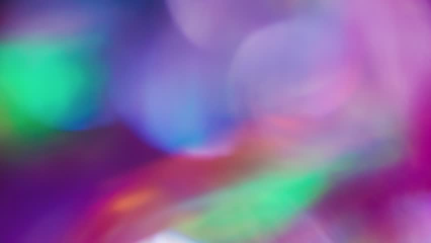 Colorful disco abstract iridescent holographic bokeh, creative background. 4k resolution. | Shutterstock HD Video #1024617599