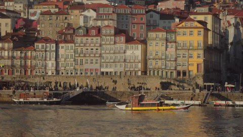 Porto / Portugal - January 2018: Boats on the river in ribeira district in Porto Portugal. View on old town buildings and harbour, Architecture of Portugal.