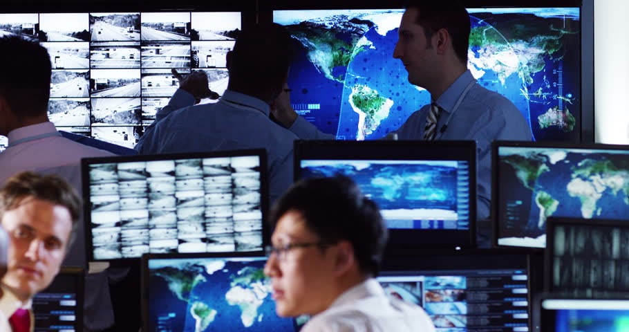 4K Security & surveillance team working in a busy system control room. Could be a meteorological weather station or airport traffic control room.  | Shutterstock HD Video #10246334