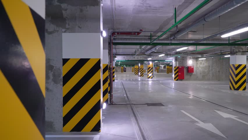 Empty underground parking garage. Cars