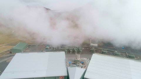 Aerial footage of a Icelandic geothermal power plant with steam rising from the hot water vents, obscuring the view