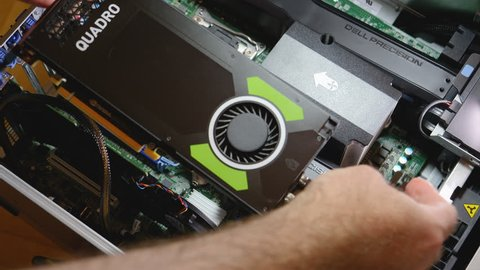 Paris, France - Feb 20, 2019: Time lapse fast motion of IT professional installing latest Nvidia Quadro RTX 5000 workstation professional video CPU Dell Precision T7910 workstation change with P4000