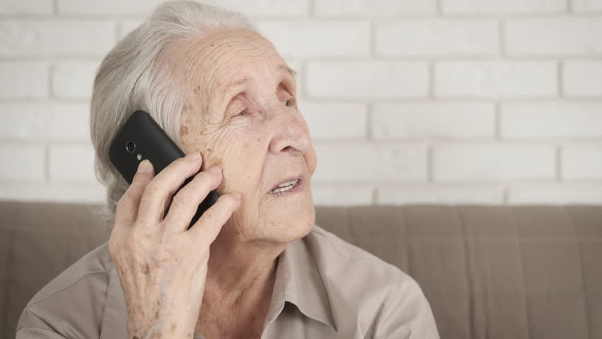 Senora called. The old lady fun tells something. Woman talking on the phone. | Shutterstock HD Video #1024717229