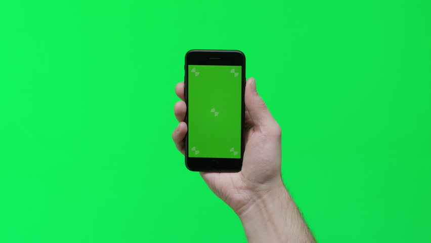 Male hand holding smart device on green screen chroma background making gestures, zoom in, pinch, swipe, scroll | Shutterstock HD Video #1024737689