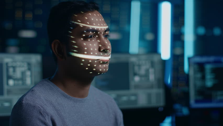 Handsome Young Indian Man is Identified by Biometric Facial Recognition Scanning Process. Futuristic Concept: Projector Identifies Individual by Illuminating Face by Dots and Scanning with Laser | Shutterstock HD Video #1024795079