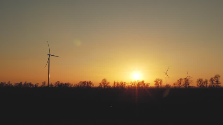 Beautiful wind turbines using clean wind energy at sunset. green energy | Shutterstock HD Video #1024852259