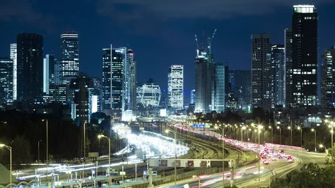 Tel Aviv Skyline and Ayalon Freeway Time lapse At Night Time, Toned In Blue Color, Israel
