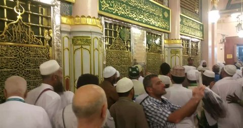 MADINAH, SAUDI ARABIA – September 2016: Muslim pilgrims visiting the beautiful Nabawi Mosque, the Prophet mosque which has great architecture during hajj  season.