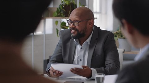 african american businessman sharing creative ideas for startup project team leader meeting with colleagues discussing corporate strategy in office boardroom