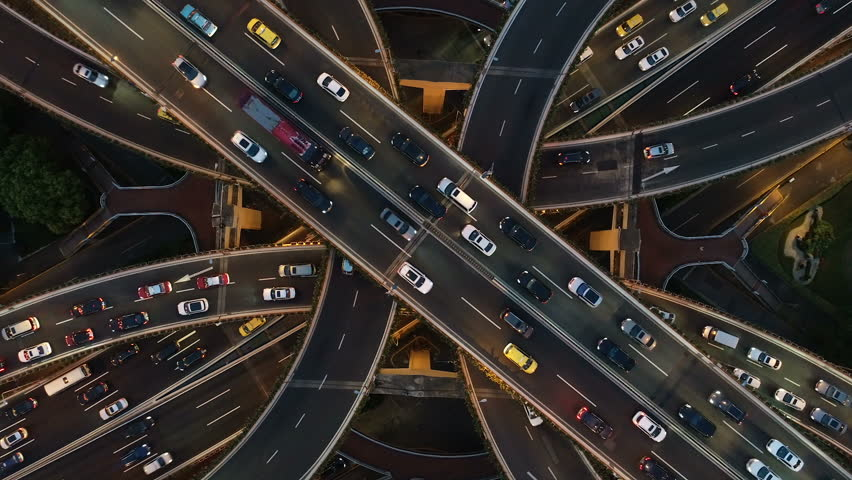 Abstract low angle drone shot of traffic driving over a busy intersection, a convergence of roads in central Shanghai city, China #1025077649
