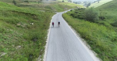 Bjelasnica, Bosnia and Herzegovina, 2nd, August 2018 - Two cyclist riding their bycicles down a road...