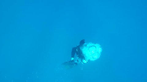 Bubbles floating up from a scuba diver below.