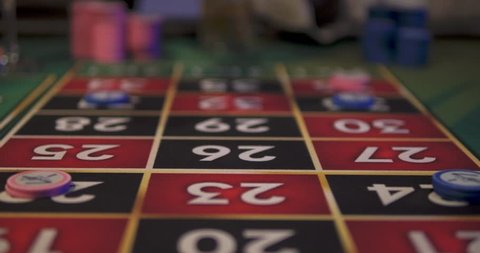 Palm Beach, Noord, Aruba - June 20 2016: Man and Woman Place Roulette Bets at Casino Table, Close Up