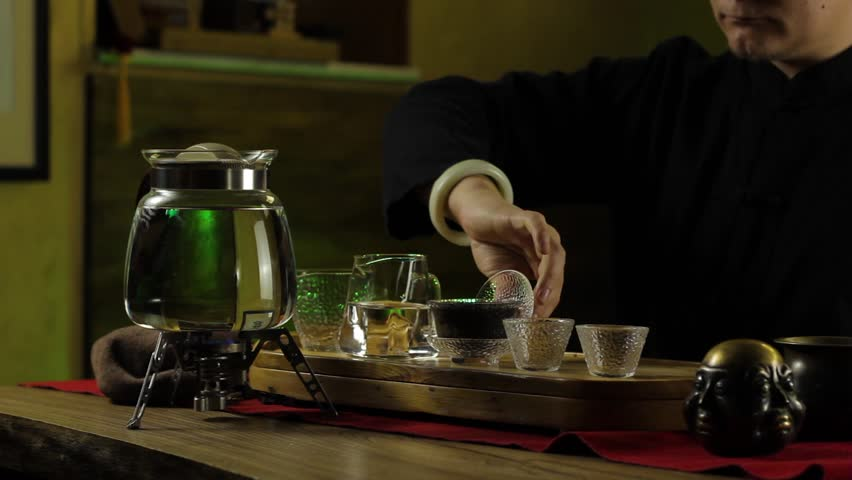 A man prepares tea according to a traditional recipe | Shutterstock HD Video #1025380439