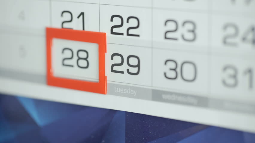Woman's hand in office changes date at wall calendar. Changes 28 to 29   Shutterstock HD Video #1025424389