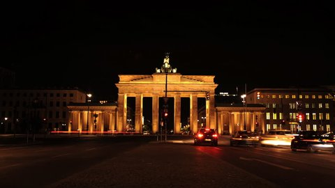 BERLIN, GERMANY - MAY 2, 2009 Time Lapse of Berlin City with Brandenburg Gate and Cars Traffic Jam Night Light