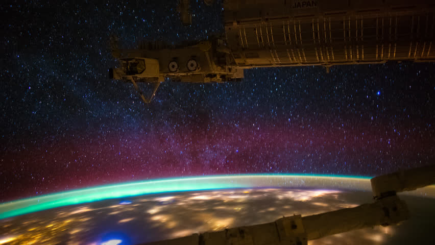 Planet Earth seen from the International Space Station with Milkway and Aurora Australis over the earth, Time Lapse. Images courtesy of NASA. Pan up motion timelapse.