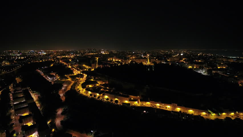 Aerial Portugal Lisbon June 2018 Night 30mm 4K. Aerial video of downtown Lisbon in Portugal at night. | Shutterstock HD Video #1025565899