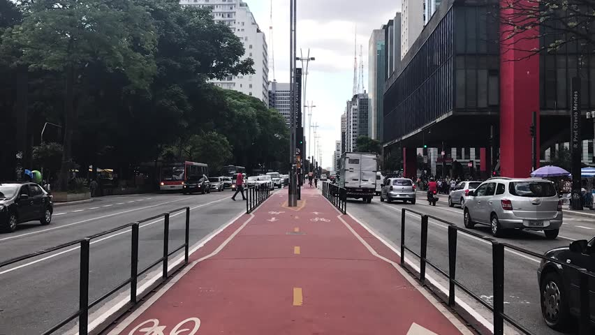 Sao Paulo, Brazil - March 5, 2019: Car traffic at rush hour on Paulista Avenue near MASP and Trianon Park, Sao Paulo city. Time lapse.