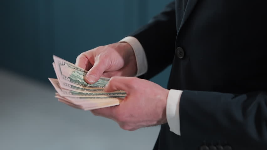 Businessman counting dollar banknotes close up #1025691689