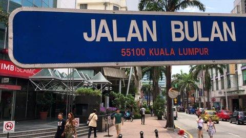 "KUALA LUMPUR - MARCH 6, 2019:  Road sign ""Jalan Bulan"" (""jalan"" translates as ""street, road"") downtown the city. Kuala Lumpur is among the fastest growing metropolitan regions in South East Asia"