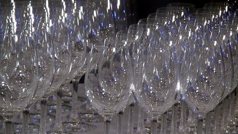 Crystal clear glass goblets shine on the banquet table. Concept of restaurant tableware for banquets and receptions.