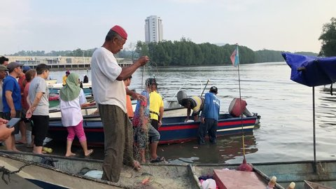 KOTA KINABALU SABAH, MALAYSIA - MARCH 8, 2019: Street scene of business activity of buying and selling at fish market in Teluk Likas, Kota Kinabalu, Sabah.